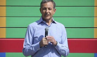 FILE - In this April 26, 2018, file photo Disney CEO Robert Iger speaks at the grand opening of Toy Story Land at Shanghai Disneyland in Shanghai, China. Iger earned $65.6 million in 2018, according to data analyzed by Equilar for The Associated Press. Disney shareholders were upset last year about his pay, and 52% of shares cast at the annual meeting voted against the compensation packages for top executives. In response, the company toughened the performance goals Iger would need to meet to get the full bonus he would be due in 2021. (AP Photo, File)