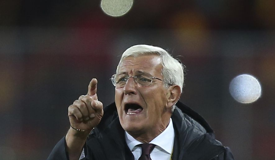 FILE - In this Nov. 15, 2016, file photo, then China's head coach Marcello Lippi gestures during the Group A World Cup 2018 Asian qualifier soccer match against Qatar, in Kunming in southwestern China's Yunnan province. Lippi is set to return for a second stint in charge of China's national team as the country targets a place at the 2022 World Cup, the Chinese Football Association announced Friday, May 24, 2019. (Color China Photo via AP, File)