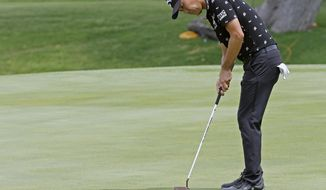 Kevin Na putts on the 18th hole during the second round of the Charles Schwab Challenge golf tournament at Colonial Country Club in Fort Worth, Texas, Friday, May 24, 2019. (Bob Booth/Star-Telegram via AP)