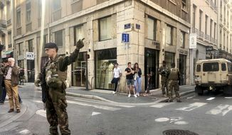 """Soldiers of French anti terrorist plan """"Vigipirate Mission"""", secure the area, near the site of a suspected bomb attack in central Lyon, Friday May, 24, 2019. A small explosion Friday on a busy street in the French city of Lyon lightly injured several people, local officials said.  (AP Photo/Sebastien Erome)"""