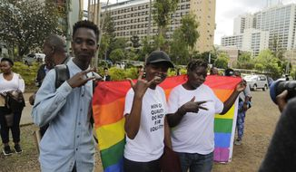Kenya gay and Lesbian activists and their supporters gather outside the Milimani Court in Nairobi, Kenya Friday, May 24, 2019. Kenya's High Court is due to rule Friday on whether laws that criminalise same sex relations are unconstitutional (AP Photo/Khalil Senosi)