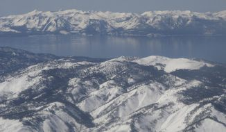 Scientists say water clarity has rebounded from an all-time low in 2017 at Lake Tahoe, pictured in this photo taken from an airplane departing from Reno, Nev. on March 2, 2017. UC Davis researches said on Thursday, May 23, 2019 that Last year's reading improved about 10 feet from the previous year and is now in line with the most recent five-year average. (AP Photo/Scott Sonner)