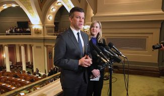 Democratic Minnesota House Majority Leader Ryan Winkler, left, and Democratic House Speaker Melissa Hortman, right, speak to reporters above the House chamber in the state Capitol in St. Paul, Minn. on the opening day of a special session to finish work on the state's $48 billion two-year budget, Friday, May 24, 2019. (AP Photo/Steve Karnowski)