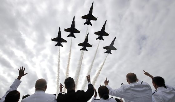 In this May 26, 2017, photo, U.S. Navy Blue Angels perform a flyover above graduating U.S. Naval Academy midshipmen during the Academy's graduation and commissioning ceremony in Annapolis, Md. (AP Photo/Patrick Semansky) **FILE**