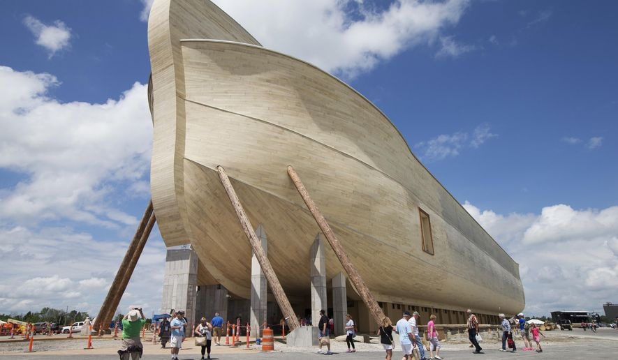 FILE - In this July 5, 2016, file photo, visitors pass outside the front of a replica Noah's Ark at the Ark Encounter theme park during a media preview day, in Williamstown, Ky. In the Bible, the ark survived an epic flood. Yet the owners of Kentucky's Noah's ark attraction are demanding their insurance company rescue them from flooding that caused nearly $1 million in property damage. (AP Photo/John Minchillo, File)