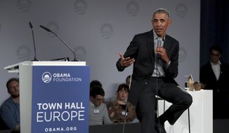 """In this April 6, 2019 file photo, former U.S. President Barack Obama speaks during a town hall meeting at the """"European School For Management And Technology"""" (ESMT) in Berlin, Germany. (AP Photo/Michael Sohn)"""
