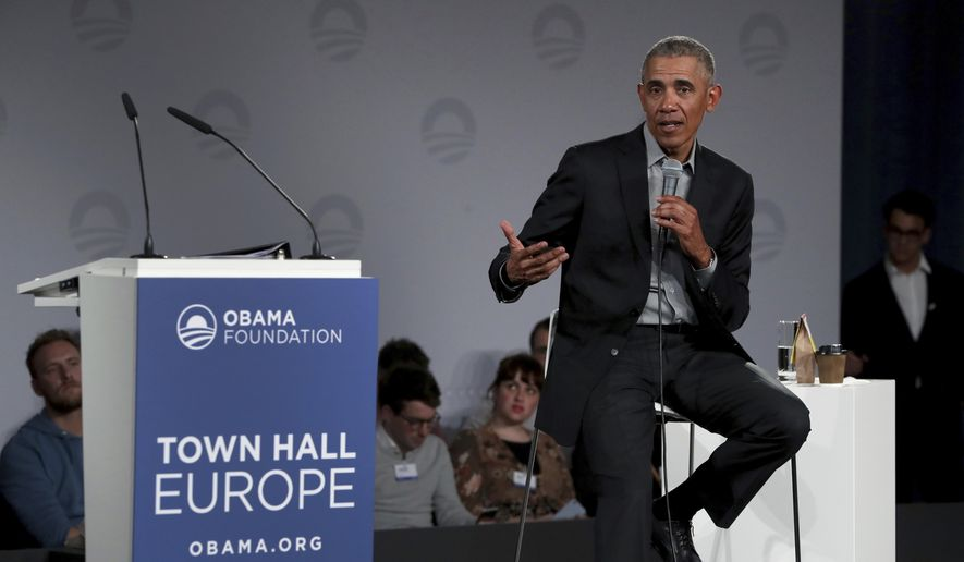 "In this April 6, 2019 file photo, former U.S. President Barack Obama speaks during a town hall meeting at the ""European School For Management And Technology"" (ESMT) in Berlin, Germany. (AP Photo/Michael Sohn)"