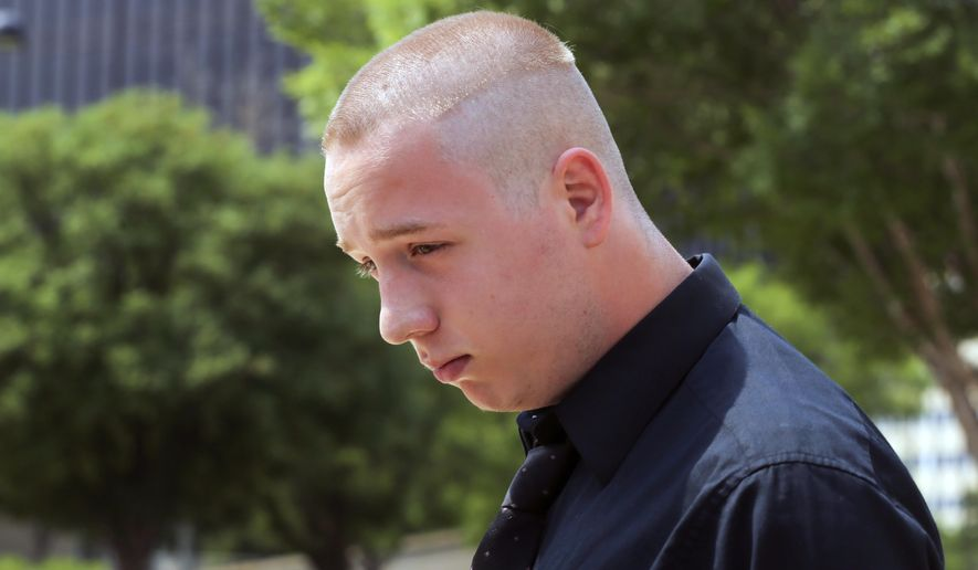 FILE - In this Wednesday, June 13, 2018 file photo, Shane Gaskill, 19, of Wichita, Kan., leaves the federal court in Wichita, Kan. Gaskill, an online gamer whose dispute over a $1.50 bet sparked a hoax call that resulted in police shooting a man who lived at his old address has struck a deal with prosecutors for an alternative to prosecution. U.S. District Judge Eric Melgren approved on Friday, May 24, 2019 the joint motion for deferred prosecution that had been filed earlier in the day by prosecutors and the attorney for 20-year-old Shane Gaskill of Wichita. (Jaime Green/The Wichita Eagle via AP, File)
