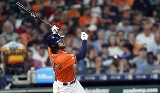 Houston Astros' Jake Marisnick hits a home run against the Boston Red Sox during the third inning of a baseball game Friday, May 24, 2019, in Houston. (AP Photo/David J. Phillip)