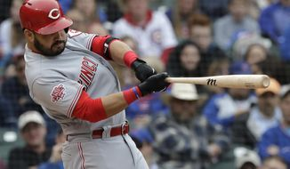 Cincinnati Reds' Eugenio Suarez hits a two-run home run during the ninth inning of the team's baseball game against the Chicago Cubs, Friday, May 24, 2019, in Chicago. The Reds won 6-5. (AP Photo/Nam Y. Huh)
