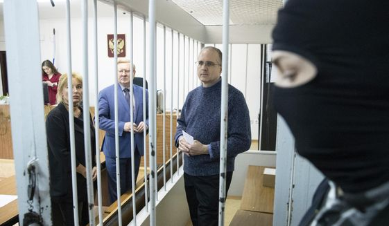 Paul Whelan, a former U.S. Marine, center, who was arrested in Moscow at the end of last year, waits for a hearing in a court in Moscow, Russia, Friday, May 24, 2019. The American was detained at the end of December for alleged spying. (AP Photo/Pavel Golovkin) ** FILE **