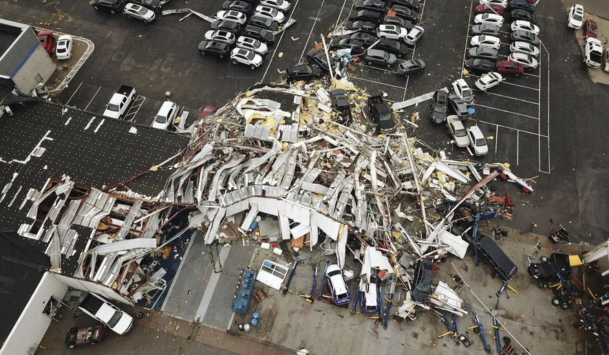 This aerial image shows severe storm damage in Jefferson City, Mo., Thursday, May 23, 2019, after a tornado hit overnight. A tornado tore apart buildings in Missouri's capital city as part of an overnight outbreak of severe weather across the state. (DroneBase via AP)