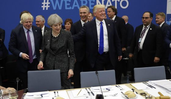 FILE - In this Thursday, May 25, 2017 file photo U.S. President Donald Trump touches the back of British Prime Minister Theresa May during a working dinner meeting at the NATO headquarters during a NATO summit of heads of state and government in Brussels. Theresa May says she'll quit as UK Conservative leader on June 7, sparking contest for Britain's next prime minister. (AP Photo/Matt Dunham, File)