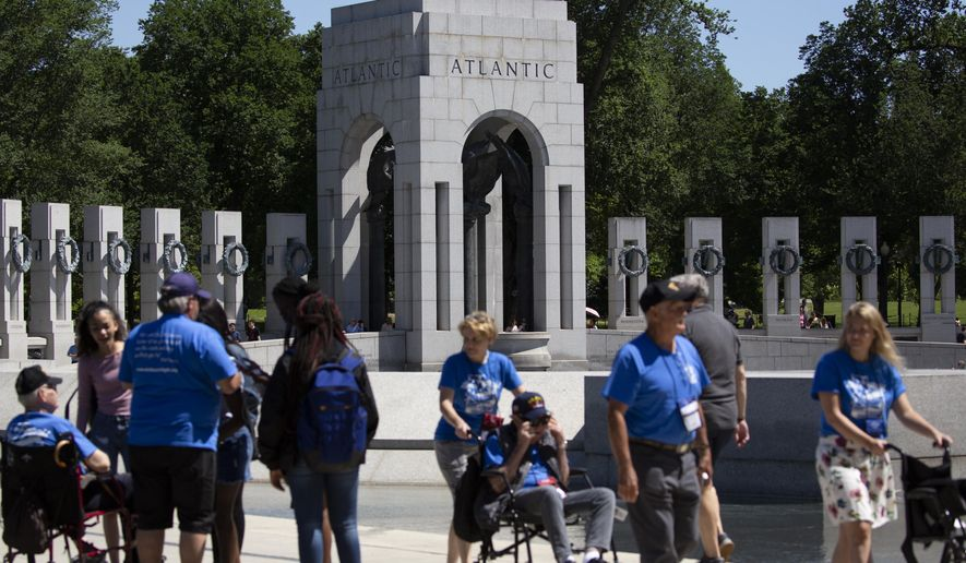 A crack is seen in rear right column of the Atlantic granite arch at the World War II Memorial on the National Mall in Washington, Friday, May 24, 2019. (AP Photo/Carolyn Kaster)