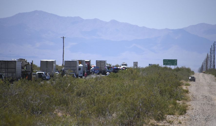 Traffic is stopped on Interstate 40 after a wrong-way crash Friday, May 24, 2019, near Kingman, Ariz. At least four people were confirmed dead in a wrong-way crash on a rural highway in the northwest part of Arizona, state troopers said Friday. The accident was just the latest in a string of fatal wrong-way wrecks this year in Arizona, which has a continuing problem with deadly crashes blamed on drivers headed the wrong way. (Vanessa Espinoza/Kingman Daily Minor via AP)