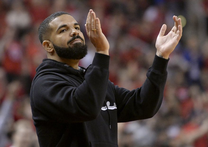 Drake cheers from courtside during the first half of Game 6 of the NBA basketball playoffs Eastern Conference finals between the Toronto Raptors and the Milwaukee Bucks on Saturday, May 25, 2019, in Toronto. (Nathan Denette/The Canadian Press via AP)
