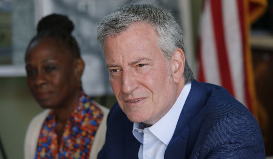 Democratic presidential candidate New York Mayor Bill de Blasio, right, and his wife Chirlane McCray speak with veterans and military families at Veterans Village II, Saturday, May 25, 2019, in Las Vegas. (AP Photo/John Locher)