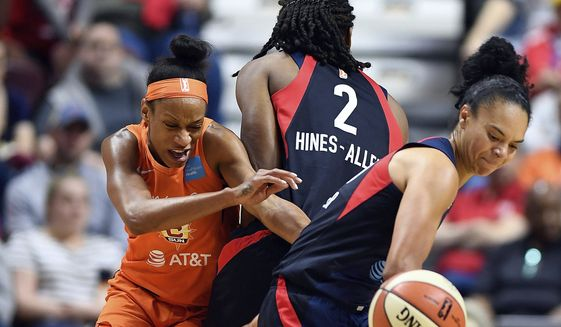 Washington Mystics guard Kristi Tolliver temporarily loses the handle on the ball as she runs Connecticut Sun guard Jasmine Thomas, left, off a Myisha Hines-Allen screen during a WNBA basketball game Saturday, May 25, 2019, in Uncasville, Conn. (Sean D. Elliot/The Day via AP) **FILE**