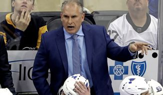 FILE - In this March 16, 2019, file photo, St. Louis Blues interim head coach Craig Berube gives instructions from behind his bench during the first period of an NHL hockey game against the Pittsburgh Penguins in Pittsburgh. Two roads diverged in a crazy world of hockey and brought them to this Stanley Cup Final. Cassidy has guided the Boston Bruins to this point a decade and a half after a disastrous tenure in Washington, and Berube took the St. Louis Blues from worst to their first final since 1970 several years after a short stint in Philadelphia. (AP Photo/Gene J. Puskar) ** FILE **