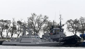In this Monday, Nov. 26, 2018 file photo, three Ukrainian ships are docked near the Kerch after been seized on Sunday, in Kerch, Crimea. A U.N. maritime tribunal has ruled that Russia must release three Ukrainian naval vessels captured by Russia in November and release 24 detained sailors. The Hamburg-based International Tribunal for the Law of the Sea delivered its verdict Saturday, May 25, 2019 on the case Ukraine brought against Russia. (AP Photo, File)