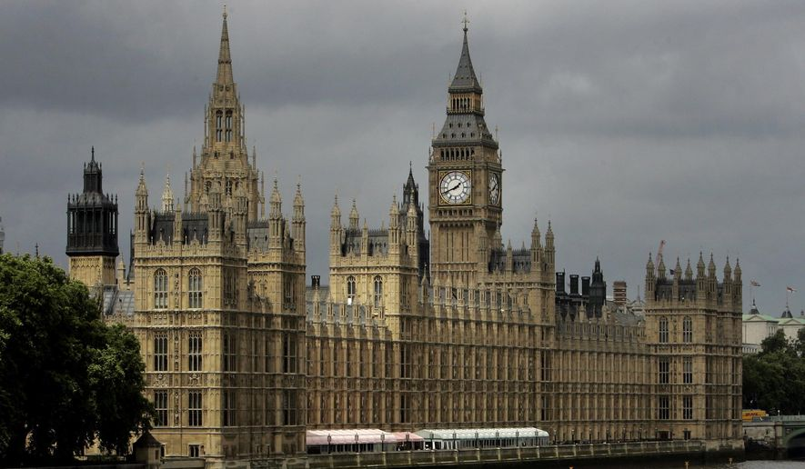 This Thursday, July 26, 2007, file photo shows a general view of the Houses of Parliament on the river Thames in London. (AP Photo/Kirsty Wigglesworth, File)