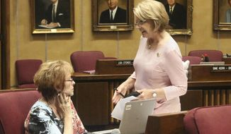 "Arizona Senate President Karen Fann, right, confers with fellow Republican Sen. Sylvia Allen in the Senate building in Phoenix, Saturday, May 25, 2019. The Arizona Senate returned to work late Saturday morning with no sign that an impasse that has held up the budget for days is close to a resolution. Still, Fann vowed to forge ahead with parts of the $11.8 billion budget package that she said are ""non-controversial."" (AP Photo/Bob Christie)"