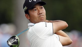 Kevin Na drives off the third during the third round of the Charles Schwab Challenge golf tournament at Colonial Country Club in Fort Worth, Texas, Saturday, May 25, 2019. (Bob Booth/Star-Telegram via AP)