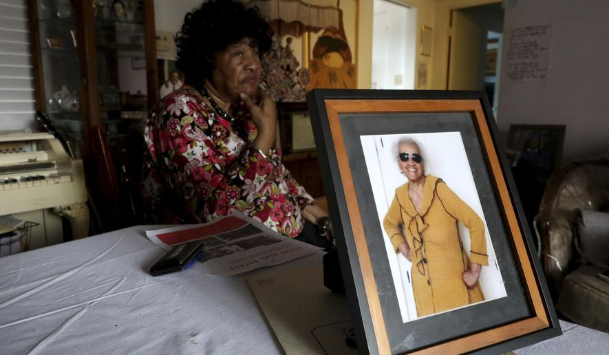 This photo taken May 22, 2019, shows 102-year-old Thelma Smith, in photo right, is being evicted from her Ladera Heights residence of 30 years. Her longtime neighbor Pauline Cooper, left, spoke about her friend's situation, in Los Angeles, Calif. Smith has until June 30, 2019, to move out.  (Gary Coronado/Los Angeles Times via AP)