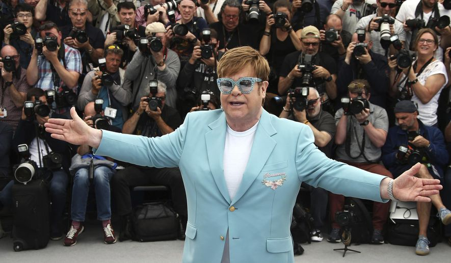 "In this Thursday, May 16, 2019, file photo, singer Elton John poses for photographers at the photo call for the film ""Rocketman"" at the 72nd international film festival, Cannes, southern France. (Photo by Joel C Ryan/Invision/AP) ** FILE **"