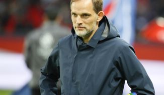 PSG's head coach Thomas Tuchel waits for the start of the League One soccer match between Paris Saint Germain and Dijon at the Parc des Princes stadium in Paris, France, Saturday, May 18, 2019. (AP Photo/Francois Mori)