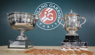 Men's single, left, and women's single cups are displayed during the draw of the French Open tennis tournament at the Roland Garros stadium in Paris, Thursday, May 23, 2019. The French Open tennis tournament starts Sunday May 26. (AP Photo/Michel Euler)