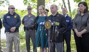 """In this file photo, Nassau Police Commissioner Patrick Ryder, foreground right, speaks to the media on Saturday, May 25, 2019 in Massapequa, N.Y. Commissioner Ryder is under fire for recent comments he made blaming the lack of diversity in his police department on Black and Hispanic """"broken homes."""" (Howard Schnapp/Newsday via AP)  **FILE**"""