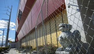 In this April 22, 2019 photo, the Lucky Dragon remains closed in Las Vegas. Developers and former managers of the Asian-themed Las Vegas casino-hotel that was built, open for a year, closed and recently sold are now facing lawsuits.  (Caroline Brehman/Las Vegas Review-Journal via AP)