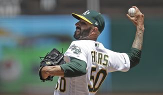 Oakland Athletics pitcher Mike Fiers works against the Seattle Mariners in the first inning of a baseball game Saturday, May 25, 2019, in Oakland, Calif. (AP Photo/Ben Margot)