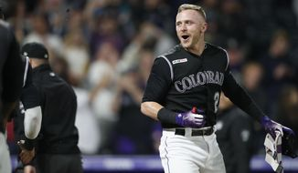 Colorado Rockies' Trevor Story smiles after hitting a game-ending, two-run home run off Baltimore Orioles relief pitcher Mychal Givens during a baseball game Friday, May 24, 2019, in Denver. The Rockies won 8-6. (AP Photo/David Zalubowski)