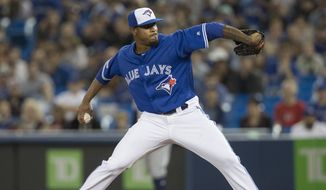 Toronto Blue Jays starting pitcher Edwin Jackson throws against the San Diego Padres during the first inning of a baseball game in Toronto on Saturday May 25, 2019. (Fred Thornhill/The Canadian Press via AP) ** FILE **