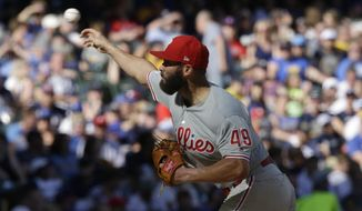 Philadelphia Phillies starting pitcher Jake Arrieta throws to the Milwaukee Brewers during the sixth inning of a baseball game Saturday, May 25, 2019, in Milwaukee. (AP Photo/Jeffrey Phelps)