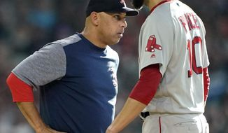 Boston Red Sox manager Alex Cora, left, talks with starting pitcher David Price before making a pitching change during the first inning of a baseball against the Houston Astros game Saturday, May 25, 2019, in Houston. (AP Photo/David J. Phillip)