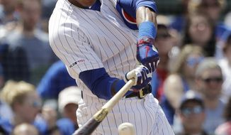 Chicago Cubs' Addison Russell hits a two-run home run during the fourth inning of a baseball game against the Cincinnati Reds, Saturday, May 25, 2019, in Chicago. (AP Photo/Nam Y. Huh)