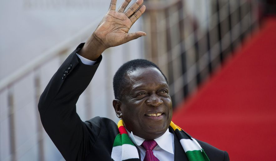 Zimbabwean President Emmerson Mnangagwa arrives for the swearing-in ceremony of Cyril Ramaphosa at Loftus Versfeld stadium in Pretoria, South Africa, Saturday May 25, 2019. Ramaphosa has vowed to crack down on the corruption that contributed to the ruling ANC' s weakest election showing in a quarter-century. (AP Photo/Jerome Delay)