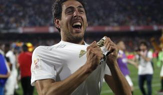 Valencia midfielder Daniel Parejo celebrates after his team's win in the Copa del Rey soccer match final between Valencia CF and FC Barcelona at the Benito Villamarin stadium in Seville, Spain, Saturday. 25, 2019. (AP Photo/Miguel Morenatti)