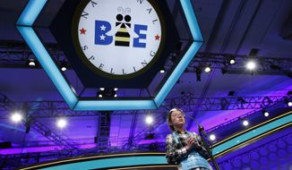 """FILE - In this May 31, 2018 file photo, Lauren Guo, 12, from Arvada, Colo., competes in the Scripps National Spelling Bee in Oxon Hill, Md.  An unremarkable sound can be the toughest thing for spellers to master at the Scripps National Spelling Bee. It's known as the schwa. It sounds like """"Uh,"""" and any vowel can make the sound.   Spellers have a variety of techniques to figure out unfamiliar schwas,  but none of the strategies is foolproof, and sometimes the only things to do are to memorize the word or guess.  (AP Photo/Jacquelyn Martin, File)"""