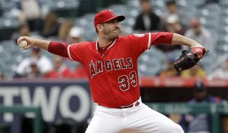 Los Angeles Angels starting pitcher Matt Harvey throws to the Minnesota Twins during the second inning of a baseball game Thursday, May 23, 2019, in Anaheim, Calif. (AP Photo/Marcio Jose Sanchez)