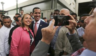 "Venezuela's opposition leader and self-proclaimed interim president Juan Guaido, center, poses for a selfie photo with supporters after a meeting of ""Plan Pais"" or Country Plan at University Catholic Andres Bello in Caracas, Venezuela, Friday, May 24, 2019.(AP Photo/Fernando Llano)"
