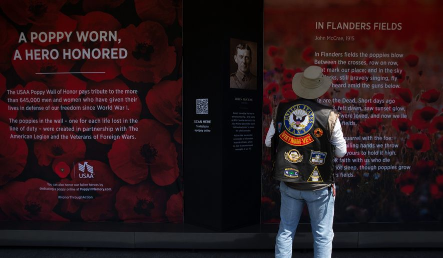 A Vietnam veteran visits the Poppy Wall of Honor on the National Mall in the District. More than 645,000 poppies are displayed in the wall for Memorial Day. (ASSOCIATED PRESS)