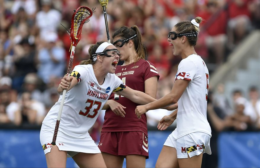 Maryland midfielders Erica Evans (33) and Jen Giles (5) celebrate after Giles' goal during the Maryland Terrapins vs. the Boston College Eagles in the 2019 NCAA Division I Women's Lacrosse National Championship Game May 26, 2019 at Homewood Field at Johns Hopkins University in Baltimore, MD. (Photo by Randy Litzinger/Icon Sportswire) (Icon Sportswire via AP Images)