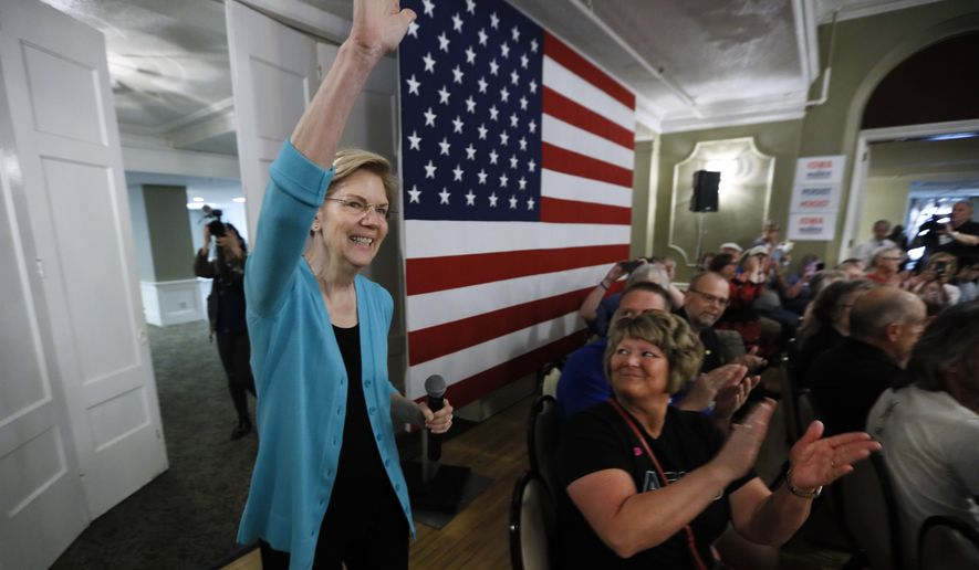 Democratic presidential candidate Sen. Elizabeth Warren enters the room to speak to local residents during a meet and greet, Sunday, May 26, 2019, in Ottumwa, Iowa. (AP Photo/Charlie Neibergall)