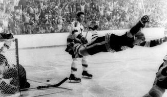 FILE - In this May 10, 1970, file photo, Boston Bruins' Bobby Orr flies through the air after scoring the winning goal past St. Louis Blues' goalie Glenn Hall during overtime in the NHL hockey Stanley Cup finals in Boston. (Ray Lussier/Boston Herald American via AP)