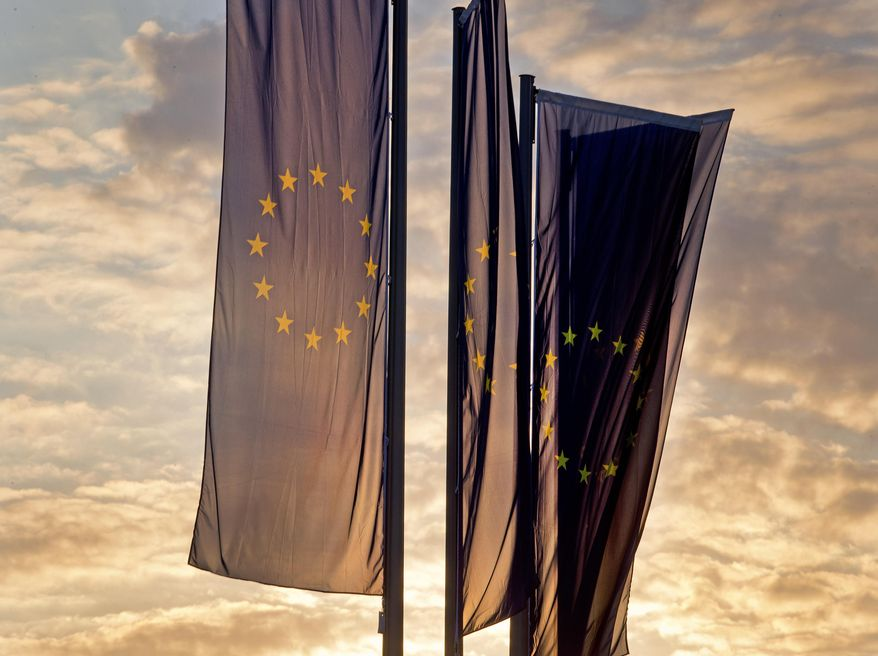 European flags blow in front of the European Central Bank as the sun rises in Frankfurt, Germany, Sunday, May 26, 2019. (AP Photo/Michael Probst)