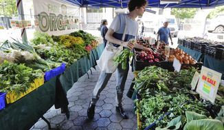 In this May 20, 2019 photo, Jonah Reider shops for vegetables in New York's Union Square Greenmarket. Reider became a national sensation when he was a Columbia University senior several years ago, booted from his dorm for running a sophisticated supper club there. (AP Photo/Richard Drew)